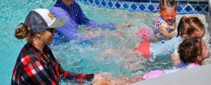 kids kicking in pool